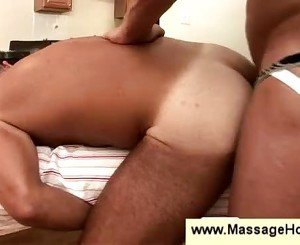 Tanned macho man gets lubed by masseur