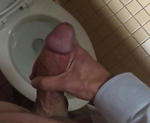 Jerking off in office men's room