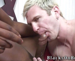 Blonde guy having bareback interracial gay sex